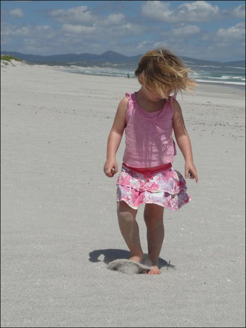 Girl playing on Langezandt beach